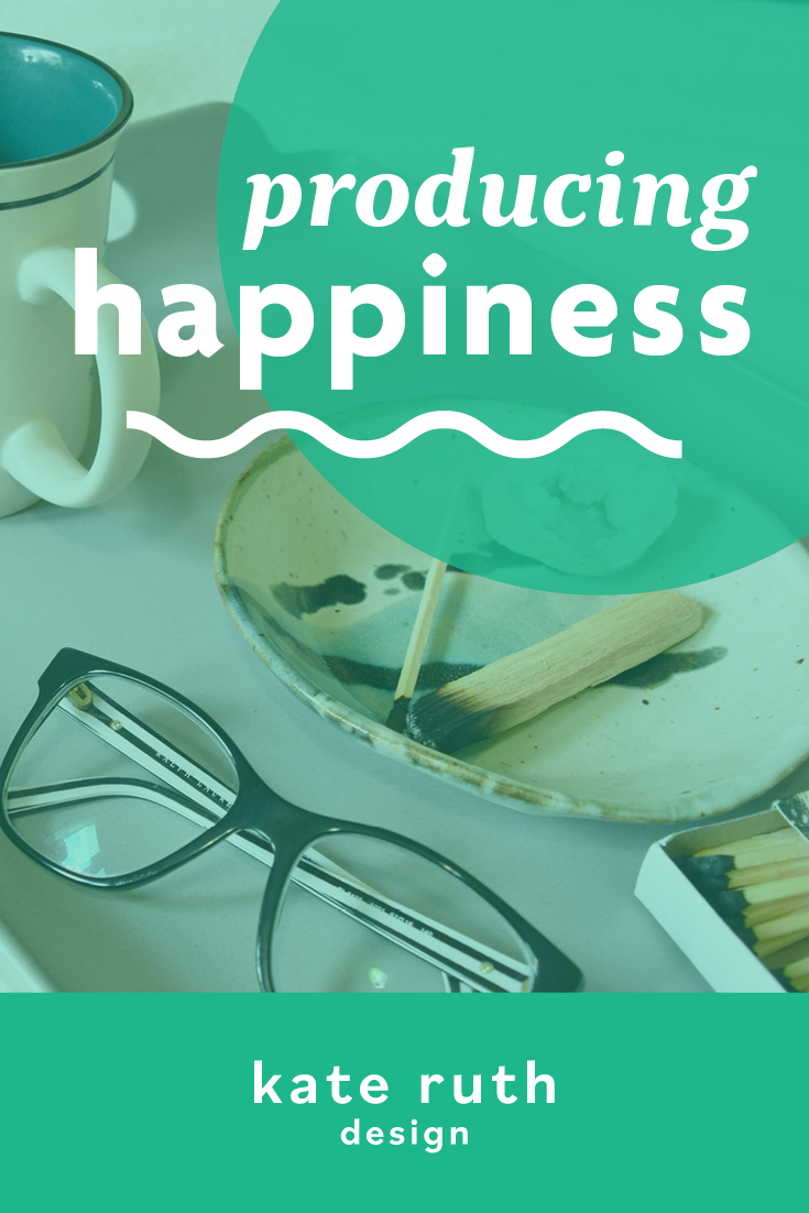 """Photo of items on a tray including glasses, coffee mug, and incense with the text """"producing happiness"""""""